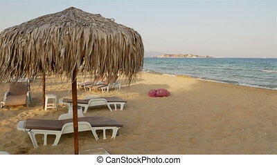 Panorama of reed straw beach umbrellas. - Panorama of reed...
