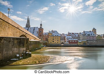 Panorama of Regensburg at winter with the Cathedral and the stone bridge, Germany