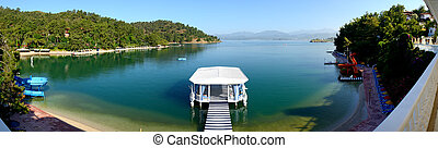 Panorama of relaxation building and beach on turkish resort, Fethiye, Turkey