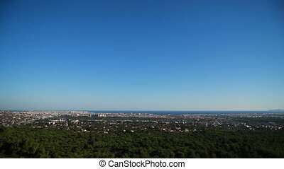 panorama of resort and port city Antalya from hill -...