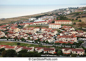Panorama of resort small town near sea in evening