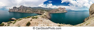 panorama of rocky sea coast and blue sky with clouds