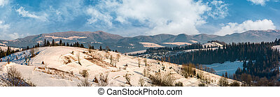 panorama of rural area in winter Carpathians. agricultural...