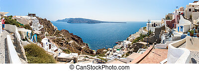 Panorama of Santorini island, Crete, Greece. White concrete staircases leading down to beautiful bay with clear blue sky and sea