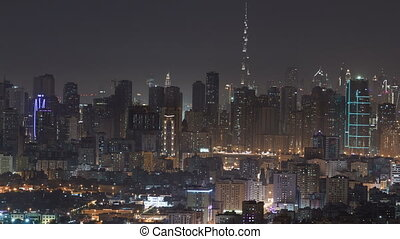 Panorama of Sharjah and Dubai from Ajman rooftop night timelapse, United Arab Emirates