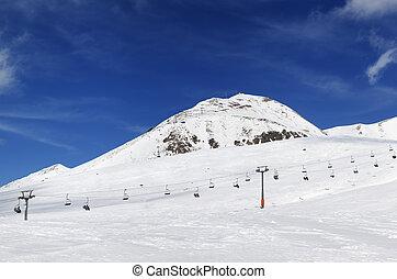 Panorama of ski resort at sunny winter day