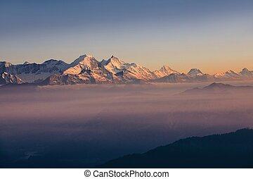 Panorama of snowcapped mountain range at sunset. View from Pilatus mountain, Luzern, Switzerland