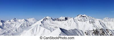 Panorama of snowy mountains. Caucasus Mountains, Georgia, view from ski resort Gudauri.
