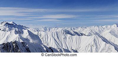 Panorama of snowy mountains in nice day. Caucasus Mountains, Georgia, view from ski resort Gudauri.