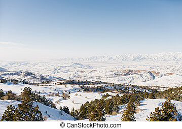 Panorama of snowy slopes covered with snow in Sunny weather. Winter landscape in the mountains of the Beldersay ski resort