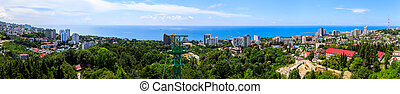 panorama of Sochi, multi-level houses on the Black Sea coast. View from the mountain of the botanical garden