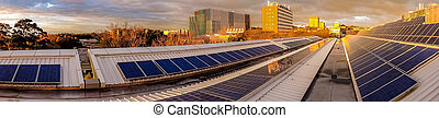 Panorama of solar panels on rooftop - Afternoon storm clouds...