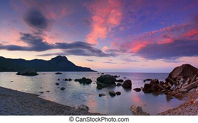 Panorama of sunrise in the sea bay