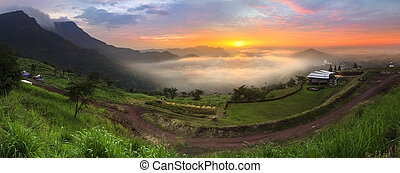 Panorama of sunrise landscape in the sea of mist at dawn, Thailand