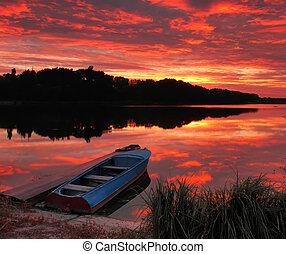 Panorama of sunrise over the lake
