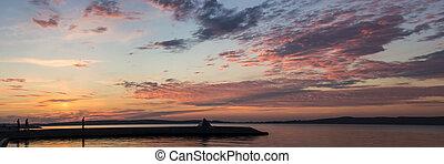 Panorama of sunset on lake