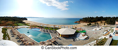 Panorama of swimming pools and bar by a beach at the luxury hotel, Thassos island, Greece
