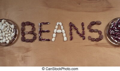 Text From Beans On The Wooden Table