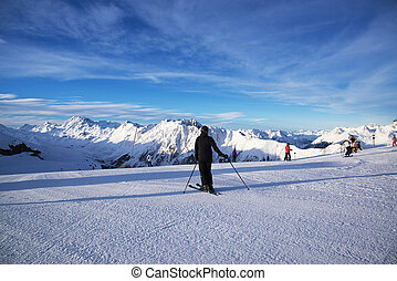 Panorama of the Austrian ski resort Ischgl with skiers.