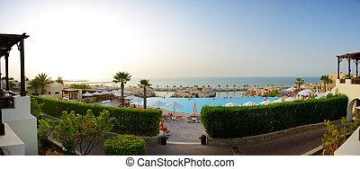 Panorama of the beach at luxury hotel in sunset, Ras Al Khaima, UAE