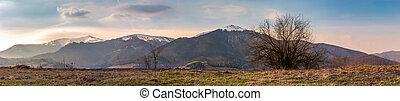 panorama of the Borzhava mountain ridge with snowy tops....