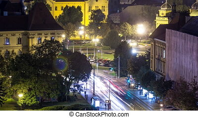 Panorama of the city center night timelapse shoot from top of the skyscraper with a view to the intersection in front of national theater and museum in Zagreb, Croatia.