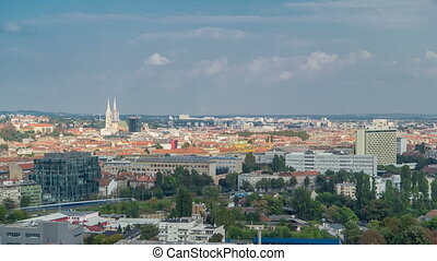 Panorama of the city center timelapse of Zagreb, Croatia, with modern and historic buildings, museums in the distance.