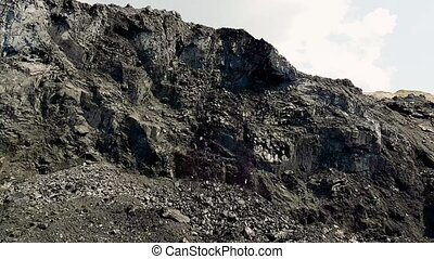 Panorama of the coal mine. View of the quarry. Rolling coal....