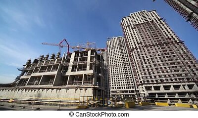 Panorama of the construction site of high-rise buildings -...