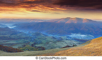 Panorama of the dramatic autumn sunset in the mountain