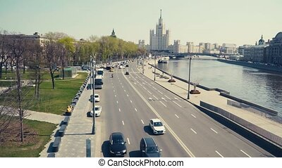 Panorama of the embankment of the Moscow river, which go cars