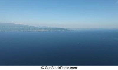 Panorama of the gorgeous Lake Garda surrounded by mountains,...