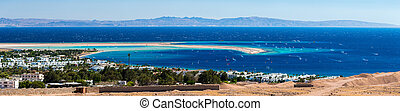 Panorama of the lagoon full of windsurfers in the town of Dahab, Egypt