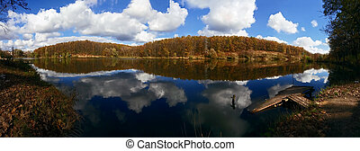 Panorama of the lake in the autumn forest