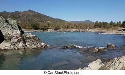 Panorama of the mountain river, turquoise water, summer and autumn