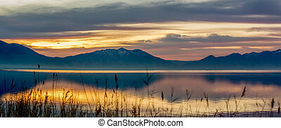 Panorama of the mountains and lake at sunrise