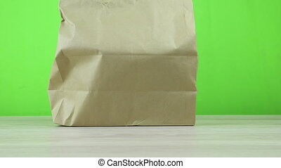 Panorama of the Paper Eco Bag on green background close-up ...