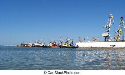 port with docks and hoisting cranes