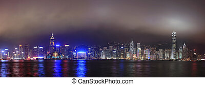 Panorama of the skyline of Hong Kong at night, with mist