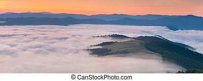Panorama of the summer sunrise in the mountains