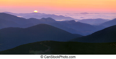Panorama of the sunrise in the mountains
