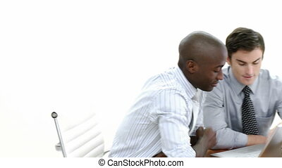 Panorama of two businessmen working together with a laptop