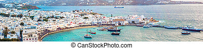Panorama of view of traditional greek village with white houses on Mykonos Island, Greece,