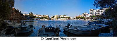 Agios Nikolaos - Panorama of Voulismeni lake with boats in ...