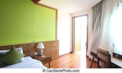 panorama of waving window curtains in hotel room - panorama...
