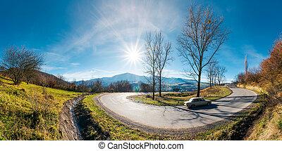 panorama of winding serpentine road in november - panorama...
