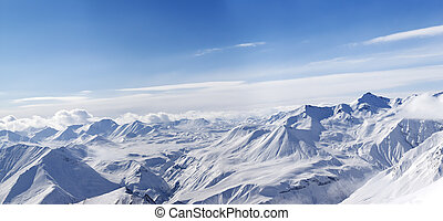 Panorama of winter mountains in nice day. Caucasus Mountains, Georgia, Gudauri. View from ski slope