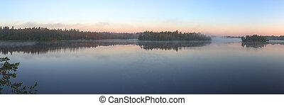 wood lake with morning fog