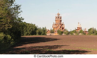 Panorama. Old large wooden orthodox church. Summer sunny day.