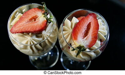panorama on mousse creamy dessert with sliced strawberry